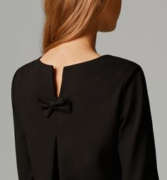 DRESS WITH BOW AT THE BACK
