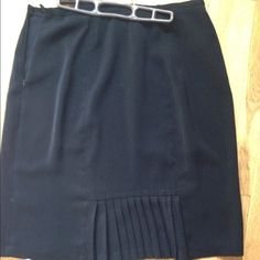 A line skirt with kickpleat! This is an adorable woman skirt. Plus sized to fit the discerning career woman. Made by Sag Harbor. Size 16. The picture shows the back of the skirt. The front is straight. Color is dark black Sag Harbor Skirts