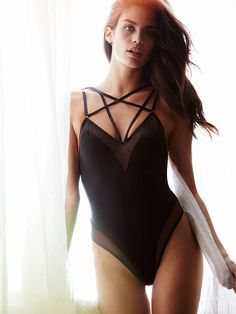 Kinda makes you wonder why ALL lingerie isn't strappy and outlined in sheer mesh.   Victoria's Secret Mesh Strappy Teddy