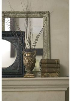 layering mirrors on a mantle & branches for reflection