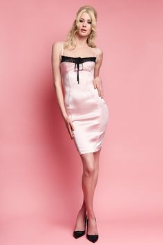 Cut to pink perfection, the Carine Bardot Dress is a classic Wheels & Dollbaby style, inspired by the glamour of fashion icon Brigitte Bardot. Constructed in our deluxe imported, baby pink stretch satin, this style features an invisible zipper closure and vent at the centre back. The romantic bodice is softly ruched and gathers with an adjustable petite Swiss velvet ribbon drawstring and skinny straps. Add the velvet slim 50's belt for the perfect accessory. The Carine Bardot…