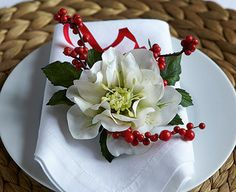 Lovely white hellebore bunches bring the beauty of winter flowers to a Christmas table setting