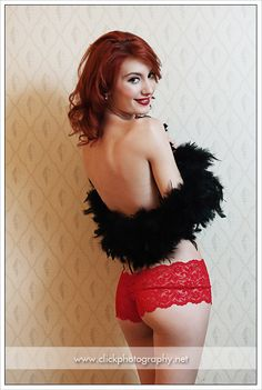 Some of my boudoir work.  Black feather boa and red lace boy shorts.