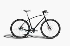 "Budnitz Model No. 3 - ""Endeavoring toward the ideal urban bicycle are a jet-black body with 29″ wheels, a cantilever frame designed to absorb shock, and a carbon belt drive system in favor of a traditional bike chain."""
