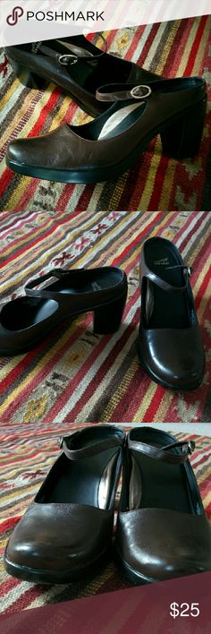 Brown black slip on dansko Mary Jane buckle heels More of an 8.5 / 9 than 39.5. wish they fit :( just a tad small. Comfy clog slip on heels. So classy and simple. Simple rubber heel make them great for work out dressing up. Only worn once. Spot in first pic just water, I washed them :) not there anymore Dansko Shoes Heels