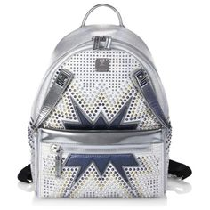 dual stark cyber studs metallic leather backpack by MCM. Futuristic studded metallic design with zip-off pouch. Top handle. Adjustable backpack straps. Two-way zip-around clo...