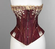 Corset, 1876, American, via The Metropolitan Museum of Art, New York    Known as the 'Bon Ton', this corset was awarded the bronze medal at the Centennial Exposition. The fine embroidery representing traditional motifs of oak leaves and wheat ears symbolize well-being and prosperity.