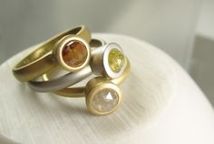 Stack of rose cut diamond modern bezel rings in yellow and white gold by Spexton.com