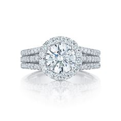 With not one, not two, but three stunning diamond filled bands leading their way up to the brilliant round center diamond, this Tacori engagement ring is absolutely breathtaking. Tacori style no. HT2551RD75