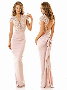 867c2a5b06d4 Long fitted dress with lace detailing to the top and a ruffle design to the  back 567
