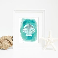 Set on an aqua watercolor background, this scallop sea shell wall art print is great for any home, office or nursery. It will bring the beach into your home in an instant!