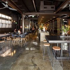 Design firm Zwei took on the double-fronted warehouse project, using black steel as the framework for a pumped up interior which is both high-energy and low-light...