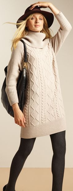 This cute sweater dress looks like a comfy thing to wear on a long flight.