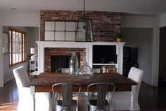 Fireplace center of open room. Dining area on one side/den on other?