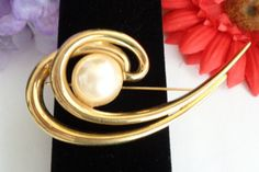 """Vintage Givenchy Classic Couture Faux Pearl Brooch Signed in a Goldtone Finish Measures 3"""" and is Signed. by CCCsVintageJewelry on Etsy"""