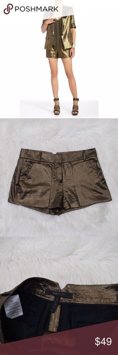 "BCBG Maxazria black gold Bruna shorts Excellent condition, size XS. Waist across 15"" Waist down 10.5"" Inseam 3"" BCBGMaxAzria Shorts"