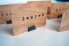 Binder clips to hold place cards or table numbers, via hippanonymous: DIY Wooden Place Cards