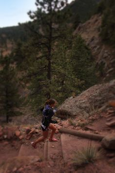 Simple Hydration Ultra Team Runner Sandi Nypaver climbing up a trail with her Simple Hydration Bottle.