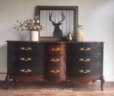 Ginger Lane fashioned this gorgeous buffet with General Finishes Lamp Black Milk Paint and Java Gel Stain.