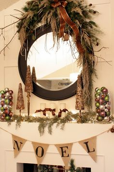 I want this garland! Also, the glass canisters filled with ornaments are beautiful.