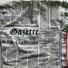 John GALLIANO top with newspaper print design John GALLIANO (designer for Givenchy and Dior) white stretch top with a black newspaper print design. Very cool and fun details. It is a size Small. Great condition (no yellow sweat marks on this white top!!) Great style regardless your age:) John Galliano Tops Tees - Short Sleeve