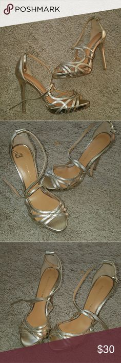 gold strappy heels size 7 Badgley Mischka Gold strappy heels size 7. these are used and have signs of wear on the sole. outer sandal is in great condition. Badgley Mischka Shoes Heels