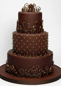 What a lovely chocolate and gold three-tier cake! This is perfect for weddings. It looks simple but it sure is sophisticated. The chocolate tone makes it l Beautiful Wedding Cakes, Gorgeous Cakes, Pretty Cakes, Amazing Cakes, Round Wedding Cakes, Cake Wedding, Wedding Bands, Cake Wrecks, Occasion Cakes