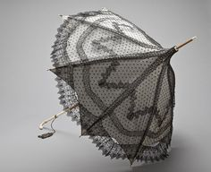 Parasol, c. 1865: Silk lace, silk plain weave (taffeta), wood, ivory (Los Angeles County Museum of Art collection)