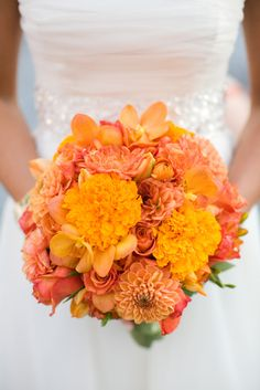 dahlias & marigolds, but mix in some dusty miller and some succulents to bring in the silver tones