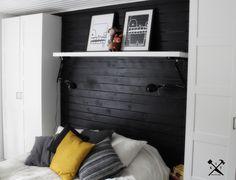 Cabecero de cama hecho con planchas de madera