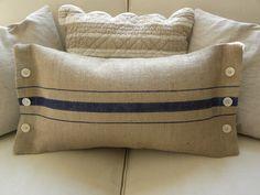Beachy coastalblue stripes burlap faux grainsack lumbar pillow cover with buttons. $32.50, via Etsy.