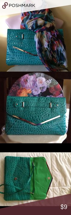 """Charming Charlie's Clutch and Scarf Pretty teal/green vinyl envelope clutch with removable strap. Strap is 25"""" long. Clutch measurers 12.5 X 8. Inside pockets and zipper compartment. Also included is a pretty cotton scarf. Pink, teal, orange, blue, yellow and white. Charming Charlie's Bags Clutches & Wristlets"""