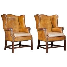 Pair of Leather Wingback Chairs | From a unique collection of antique and modern wingback chairs at http://www.1stdibs.com/furniture/seating/wingback-chairs/