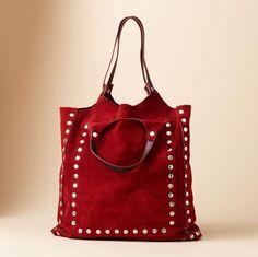 metal studded suede bag.  Shoulder and arm straps