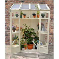 The Hartwood Victorian Tall Wall Greenhouse is flexible and compact. The Greenhouse includes two heights of shelving and the middle shelves can be adjusted to accommodate any taller plants. The greenhouse has two opening vents suitable for use with aut Victorian Greenhouses, Wooden Greenhouses, Lean To Greenhouse, Backyard Greenhouse, Greenhouse Ideas, Greenhouse Wedding, Cheap Greenhouse, Diy Mini Greenhouse, Homemade Greenhouse