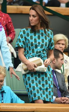 Kate: From Berkshire to Buckingham:  The Duchess of Cambridge at Wimbledon, July 6, 2014.  The Duchess recycled the Jenny Saunders dress she first wore on the tour of South East Asia in 2012.