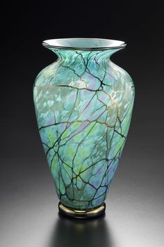 Serenity Vase by David Lindsay. Golden ribbons dance across this lustrous blown glass vase with a soft, iridescent finish created using the fuming technique.