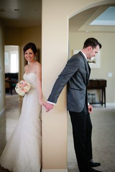 Pre Ceremony pics. Bride and Groom hold hands