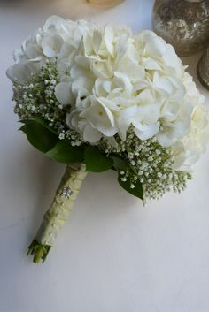 a bridesmaids posy of clustered hydrangeas, surrounded by a collar of gypsophila. - a bridesmaids posy of clustered hydrangeas, surrounded by a collar of gypsophila & soft green folia - Small Wedding Bouquets, Hydrangea Bouquet Wedding, Tulip Wedding, White Wedding Flowers, Bride Bouquets, Bridal Flowers, Gypsophila Bouquet, Wedding Centerpieces, Wedding Decorations