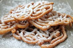 Easy Funnel Cake Recipe (Ingredients: 1-3/4 cups of Milk (plus more if necessary) 2-1/2 cups of All Purpose Flour 2 Eggs 1/4 cup of Granulated Sugar 1/2 tsp of Salt 1 Tbsp of Baking Powder 1 tsp of Vanilla Extract Vegetable Oil for Frying Confectioner Sugar)