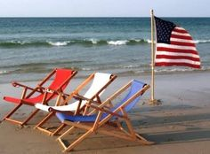 red, white and blue beach chairs