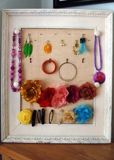 I made a jewelry and hair accessory holder for myself. See it here: http://www.ouruglyhome.com/2011/08/jewelry-and-hair-accessory-holder.html