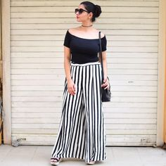 Street style!! Black off-shoulder top with black and white striped palazzos.