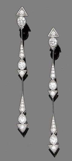 A pair of diamond pendent earrings.  Each elongated drop set with brilliant-cut diamonds in geometric collets, diamonds approx. 1.70cts total, French assay marks, length 6.8cm