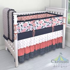 Crib bedding in Solid Navy, White and Pink Polka Dot, Coral Confetti, Navy Herringbone, Navy and Coral Diamond Dot, Light Coral Lattice, Coral Pink and Navy Floral, Solid Light Coral. Created using the Nursery Designer® by Carousel Designs where you mix and match from hundreds of fabrics to create your own unique baby bedding. #carouseldesigns