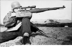 German sniper with a t K-98 , 8mm Mauser