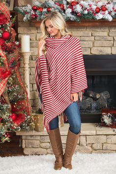 This beautiful earth toned fringe poncho is such a gorgeous way to rock neutrals this season! We love the red and cream stripes paired with the adorable fringe at the end!