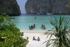 """For those who have seen the film """"The Beach"""" starring Leonardo DiCaprio, this is The Beach. Maya Bay, as it is called, is located in Koh Phi Phi Leh Thailand and unlike the movie, there is a gap between the two encompassing mountain ridges. Director Danny Boyle had the gap digitally connected in post production to give it a more exotic feel. Gap or no gap, I'm sold."""