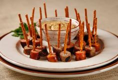 Keep up with the spirit of #Oktoberfest with some German Sausage Pretzel Skewers using Snyders Pretzel Sticks #Yum   2 (12-ounce) packages bratwurst 1(14-ounce) package Aidells Italian sausage with mozzarella Pretzel sticks Serve with German mustard Parsley sprigs for garnish _____  Grill sausages in an outdoor grill on the highest setting, turning brown to all sides, about 8-10 minutes.  When ready to serve, cut into bite size pieces and spear each one with a pretzel stick. Voila!