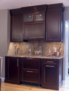 """If you have a bit more room to play with, a wet bar offers the opportunity to incorporate extra refrigeration, a second sink and even a recycling center. Designer Nathan J. Reynolds fit all this and more into this project. """"This wet bar was designed with entertaining in mind,"""" he says."""